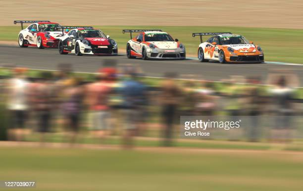 Maximilian Benecke of Germany and Team Redline leads the chasing pack during the feature race in Round Three of the Porsche TAG Heuer Esports...