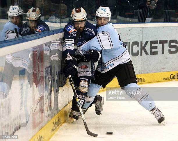 Maximilian Brandl of Hamburg challenges Daniel Sparre of Iserlohn during the DEL match between Hamburg Freezers and Iserlohn Roosters at the Color...