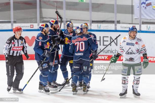 Maximilian Daubner of EHC Red Bull Muenchen celebrates after scoring his team's 2:1 goal with his team mates during the DEL match between EHC Red...