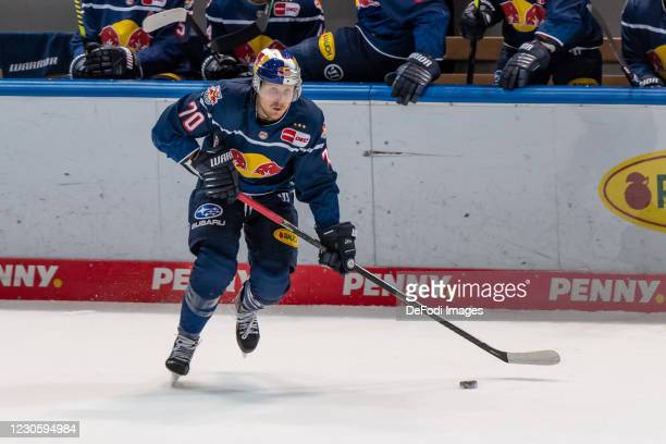 Maximilian Daubner of EHC Red Bull Muenchen controls the puck during the DEL match between EHC Red Bull Muenchen and Augsburger Panther on January...