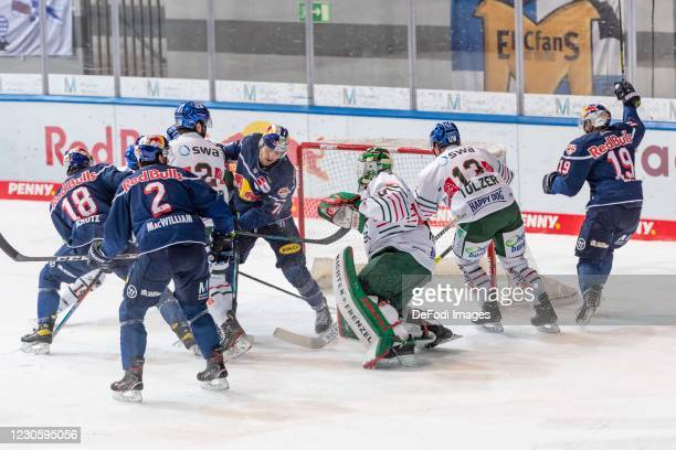 Maximilian Daubner of EHC Red Bull Muenchen scores his team's 2:1 goal during the DEL match between EHC Red Bull Muenchen and Augsburger Panther on...