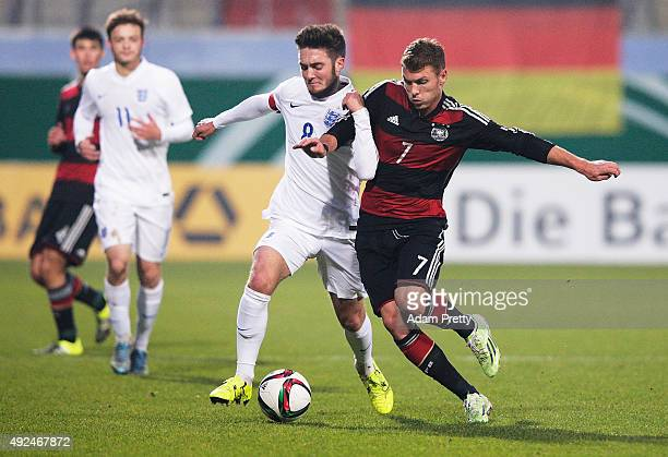 Maximilian Dittgen of Germany is challeged by Matt Grimes of England during the U20 Mercedes-Benz Elite Cup match between Germany and England at...