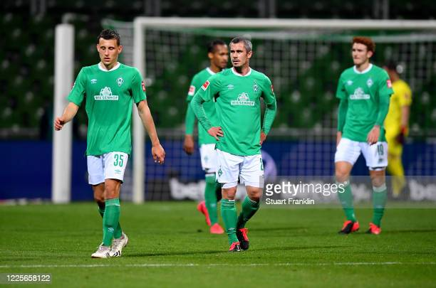 Maximilian Eggestein and Fin Bartels of Bremen look dejected after the Bundesliga match between SV Werder Bremen and Bayer 04 Leverkusen at...