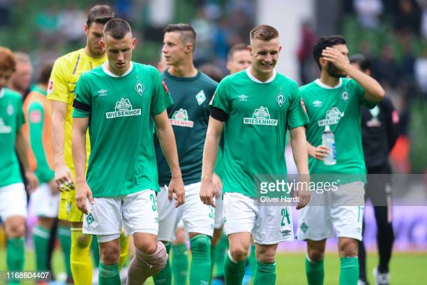 Maximilian Eggestein and Johannes Eggestein of Werder Bremen looks dejected after the Bundesliga match between SV Werder Bremen and Fortuna...