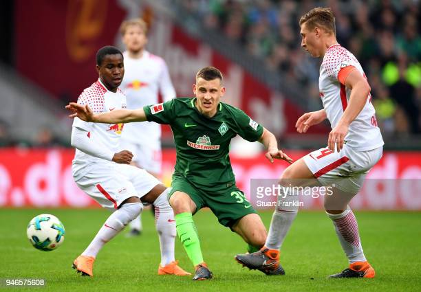 Maximilian Eggestein of Bremen and Ademola Lookman and Willi Orban of Leipzig battle for the ball during the Bundesliga match between SV Werder...