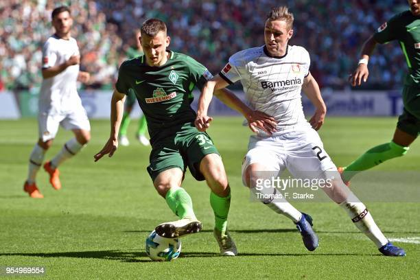 Maximilian Eggestein of Bremen and Dominik Kohr of Leverkusen fight for the ball during the Bundesliga match between SV Werder Bremen and Bayer 04...