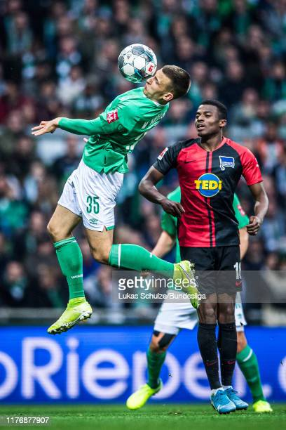 Maximilian Eggestein of Bremen and Javairo Dilrosun of Berlin in action during the Bundesliga match between SV Werder Bremen and Hertha BSC at...