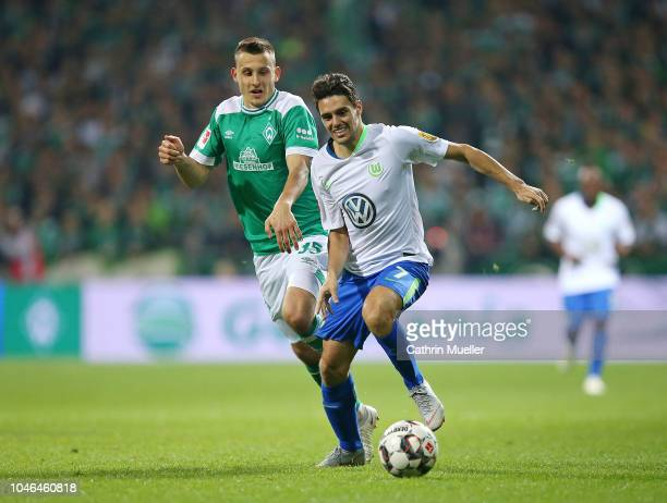 Maximilian Eggestein of Bremen and Josip Brekalo of Wolfsburg battle for the ball during the Bundesliga match between SV Werder Bremen and VfL...
