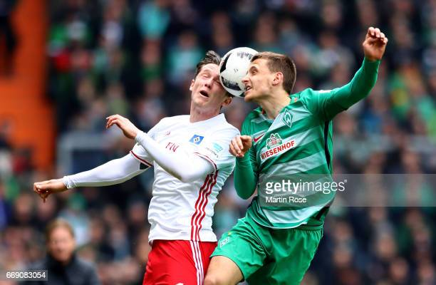 Maximilian Eggestein of Bremen and Michael Gregoritsch of Hamburg head for the ball during the Bundesliga match between Werder Bremen and Hamburger...
