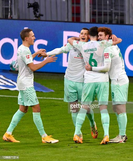 Maximilian Eggestein of Bremen celebrates his team's first goal with teammates during the Bundesliga match between FC Bayern Muenchen and SV Werder...