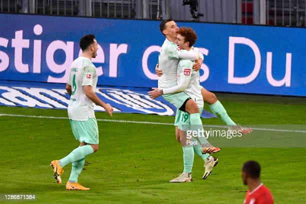 Maximilian Eggestein of Bremen celebrates his team's first goal with teammates Josh Sargent and Kevin Moehwald during the Bundesliga match between FC...