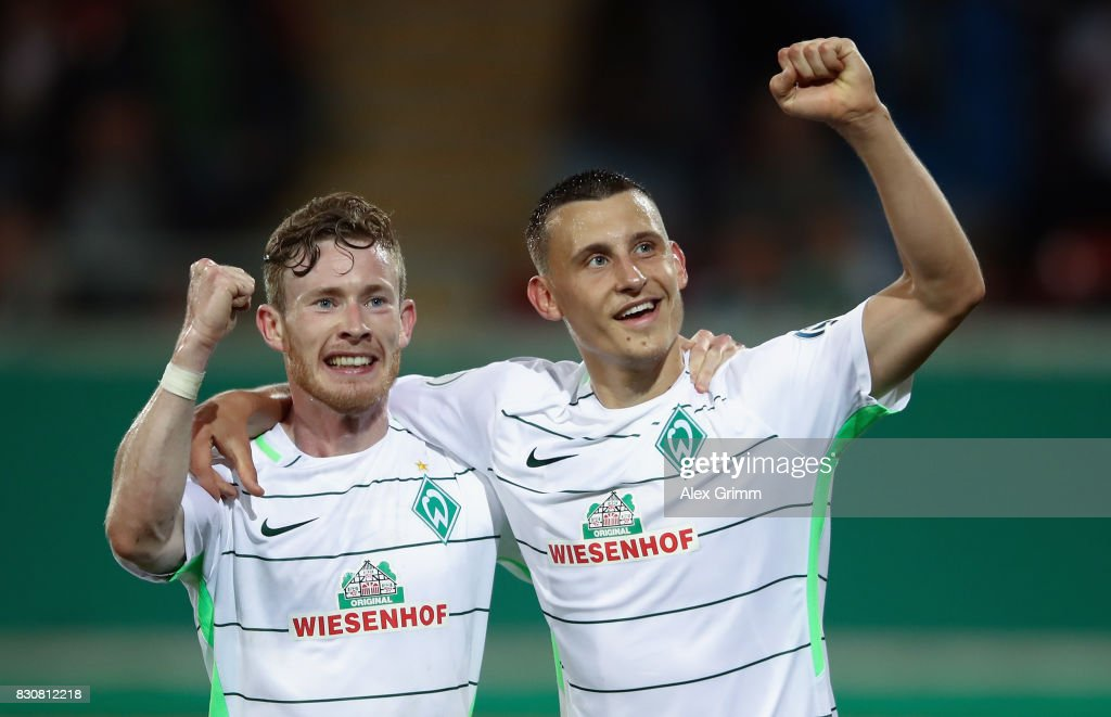 Maximilian Eggestein (R) of Bremen celebrates his team's third goal with team mate Florian Kainz during the DFB Cup first round match between Wuerzburger Kickers and SV Werder Bremen at Sparda-Bank-Hessen-Stadion on August 12, 2017 in Offenbach, Germany.