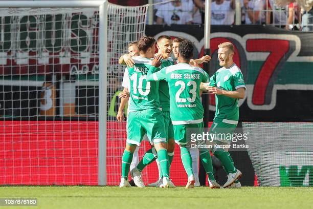 Maximilian Eggestein of Bremen celebrates the second goal for Bremen with his teammates during the Bundesliga match between FC Augsburg and SV Werder...