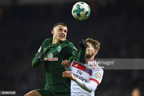Maximilian Eggestein of Bremen fights for the ball with Aaron Hunt of Hamburg during the Bundesliga match between SV Werder Bremen and Hamburger SV...