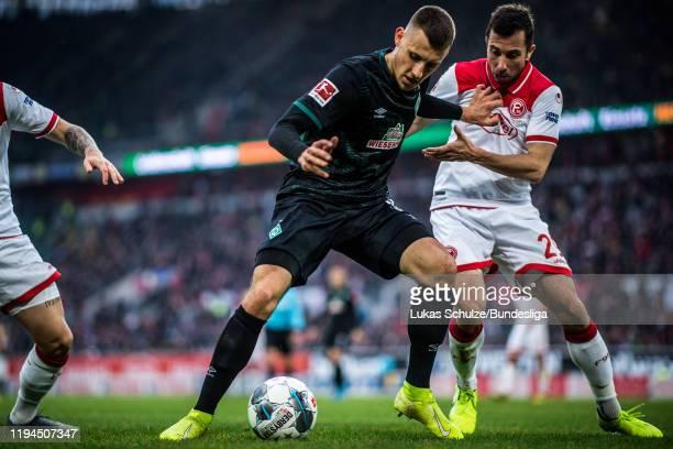 Maximilian Eggestein of Bremen in action against Markus Suttner of Düsseldorf during the Bundesliga match between Fortuna Düsseldorf and SV Werder...
