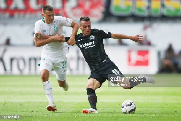 Maximilian Eggestein of Bremen is challenged by Filip Kostic of Frankfurt during the Bundesliga match between Eintracht Frankfurt and SV Werder...