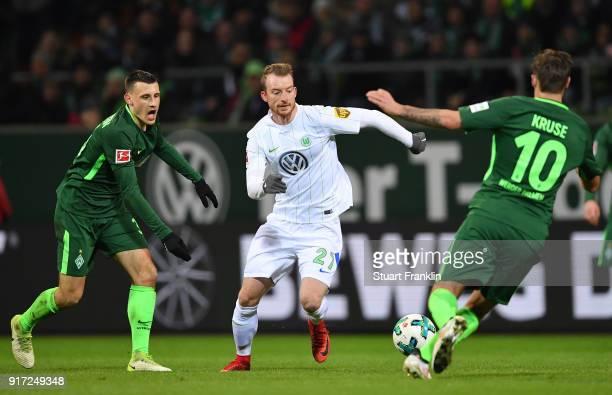 Maximilian Eggestein of Bremen is challenged by Maximilian ArnoldÊ of Wolfsburg during the Bundesliga match between SV Werder Bremen and VfL...