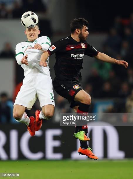Maximilian Eggestein of Bremen jumps for a header with Kevin Volland of Leverkusen during the Bundesliga match between Bayer 04 Leverkusen and Werder...