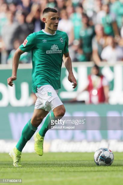 Maximilian Eggestein of Bremen runs with the ball during the Bundesliga match between SV Werder Bremen and FC Augsburg at Wohninvest Weserstadion on...