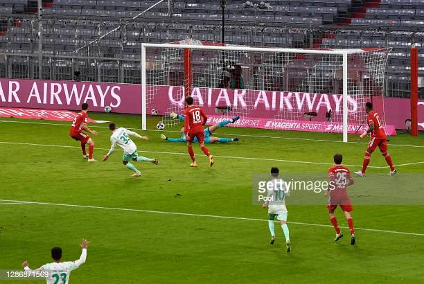 Maximilian Eggestein of Bremen scores his team's first goal during the Bundesliga match between FC Bayern Muenchen and SV Werder Bremen at Allianz...