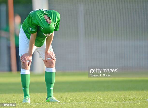 Maximilian Eggestein of Bremen stands dejected on the pitch during the B Juniors Bundesliga Semi Final match between between Werder Bremen and VfB...