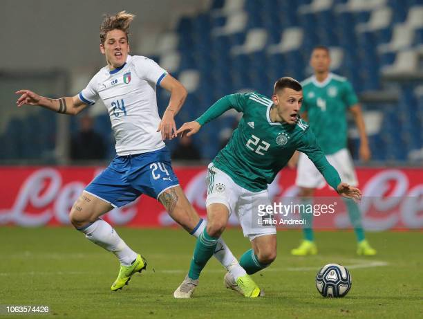 Maximilian Eggestein of Germany competes for the ball with Nicolo Zaniolo of Italy during the International friendly match between Italy U21 and...