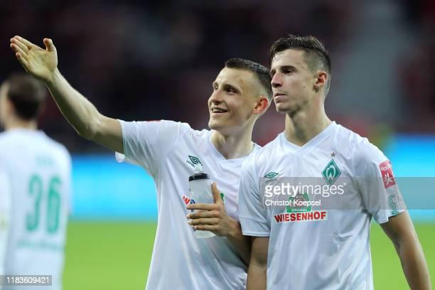 Maximilian Eggestein of SV Werder Bremen and Marco Friedl of SV Werder Bremen acknowledge the fans after the Bundesliga match between Bayer 04...