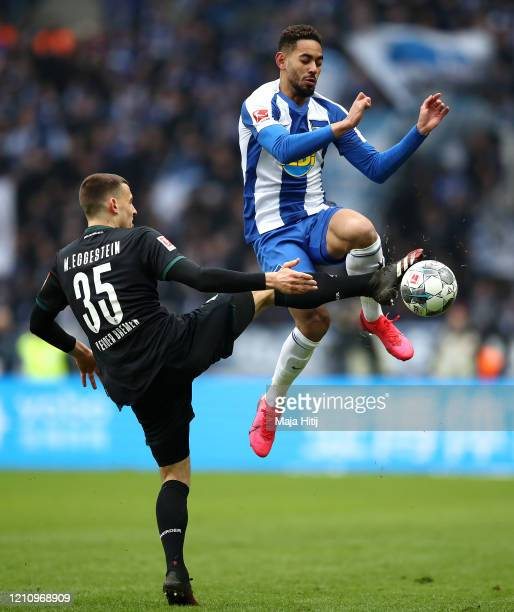 Maximilian Eggestein of SV Werder Bremen battles for possession with Matheus Cunha of Hertha BSC during the Bundesliga match between Hertha BSC and...