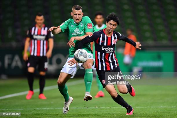 Maximilian Eggestein of SV Werder Bremen battles with Daichi Kamada of Eintracht Frankfurt during the Bundesliga match between SV Werder Bremen and...