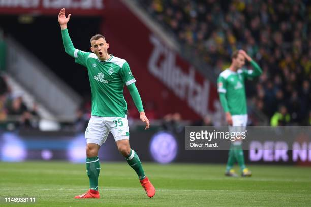 Maximilian Eggestein of SV Werder Bremen looks dejected during the Bundesliga match between SV Werder Bremen and Borussia Dortmund at Weserstadion on...