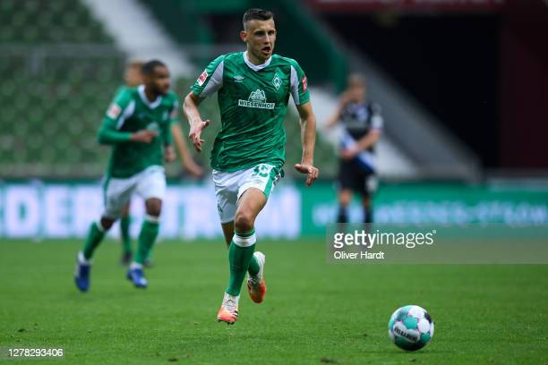 Maximilian Eggestein of SV Werder Bremen runs with the ball during the Bundesliga match between SV Werder Bremen and DSC Arminia Bielefeld at...