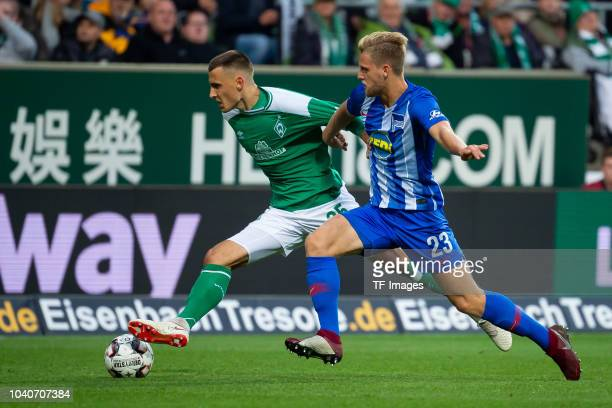 Maximilian Eggestein of Werder Bremen and Arne Maier of Hertha BSC battle for the ball during the Bundesliga match between SV Werder Bremen and...
