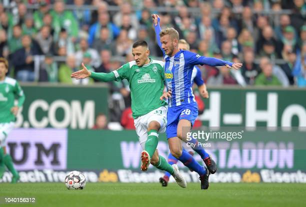 Maximilian Eggestein of Werder Bremen and Fabian Lustenberger of Hertha BSC during the Bundesliga match between SV Werder Bremen and Hertha BSC at...