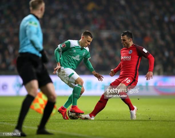 Maximilian Eggestein of Werder Bremen and Filip Kostic of Eintracht Frankfurt battle for the ball during the Bundesliga match between SV Werder...
