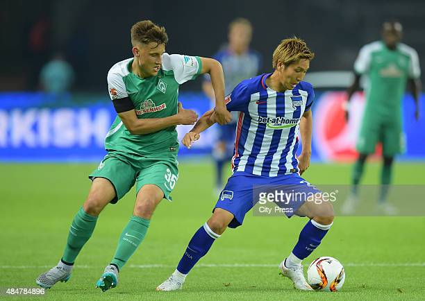 Maximilian Eggestein of Werder Bremen and Genki Haraguchi of Hertha BSC during the game between Hertha BSC and Werder Bremen on August 21, 2015 in...