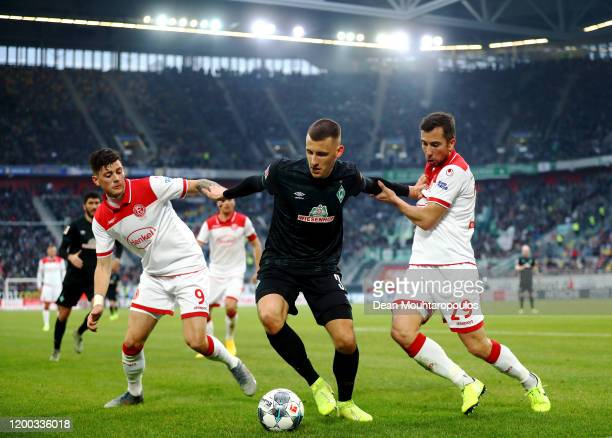Maximilian Eggestein of Werder Bremen battles for the ball with Markus Suttner and Dawid Kownacki of Fortuna Dusseldorf during the Bundesliga match...