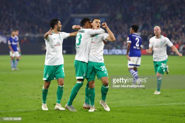 Maximilian Eggestein of Werder Bremen celebrates with teammates after scoring his team's second goal during the Bundesliga match between FC Schalke...