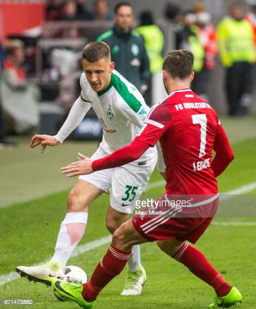 Maximilian Eggestein of Werder Bremen is challenged by Mathew Leckie of Ingolstadt during the Bundesliga match between FC Ingolstadt 04 and Werder...