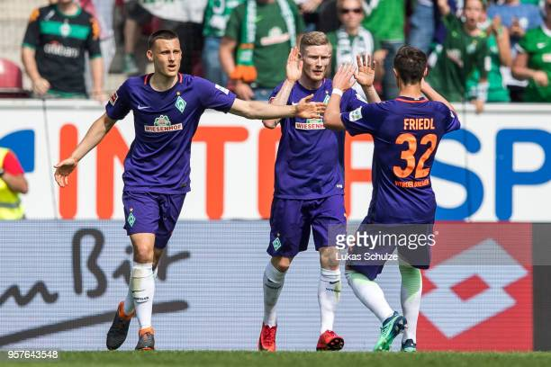 Maximilian Eggestein , scorer Florian Kainz and Marco Friedl of Bremen celebrate their teams first goal during the Bundesliga match between 1. FSV...