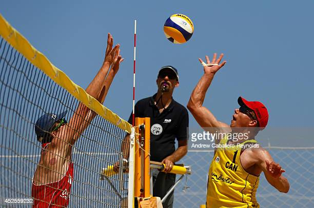 Maximilian Guehrer from Australia tries to block a spike from Lucas Palmer from Canada at the FIVB Under 21 Beach Vollyball World Championships on...