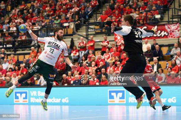 Maximilian Holst of Wetzlar scores a goal against goalkeeper Roko Peribonio of Ludwigshafen during the DKB HBL match between Die Eulen Ludwigshafen...