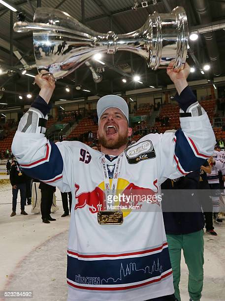Maximilian Kastner of Muenchen poses with the trophy after winning the DEL playoffs final game four between Grizzlys Wolfsburg and Red Bull Muenchen...