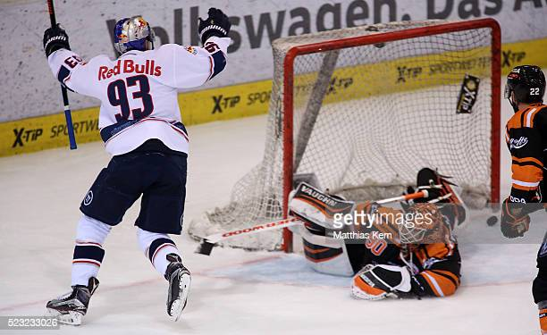 Maximilian Kastner of Muenchen scores his teams third goal during the DEL playoffs final game four between Grizzlys Wolfsburg and Red Bull Muenchen...