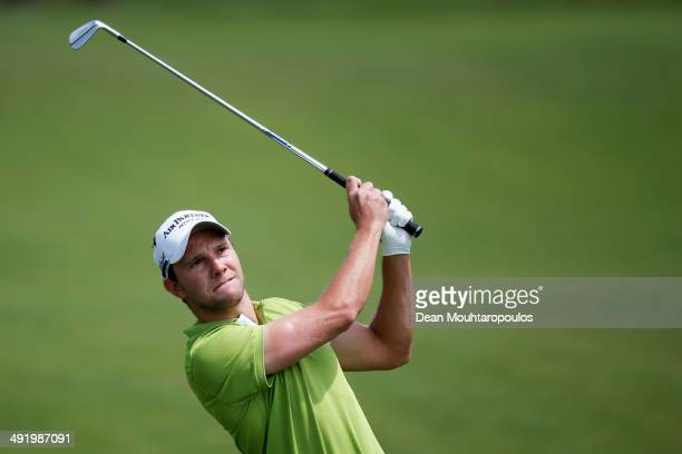 Maximilian Kieffer of Germany hits his second shot on the 1st hole during the final round of the Open de Espana held at PGA Catalunya Resort on May...