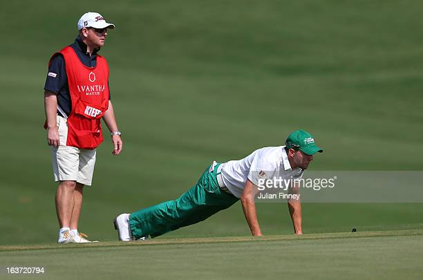 Maximilian Kieffer of Germany lines up a putt with caddie during day two of the Avantha Masters at Jaypee Greens Golf Club on March 15 2013 in Delhi...