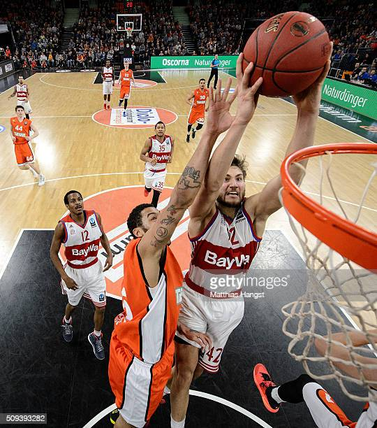Maximilian Kleber of FC Bayern Muenchen is challenged by Pierria Henry of Ulm during the Eurocup Basketball match between ratiopharm Ulm and FC...