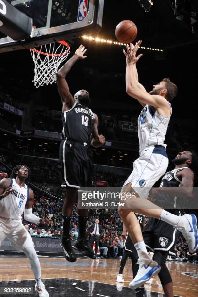 Maximilian Kleber of the Dallas Mavericks dunks against Quincy Acy of the Brooklyn Nets on March 17 2018 at Barclays Center in Brooklyn New York NOTE...