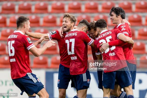 Maximilian Krauss of SpVgg Unterhaching celebrates after scoring his team's second goal with teammates during the 3. Liga match between SpVgg...