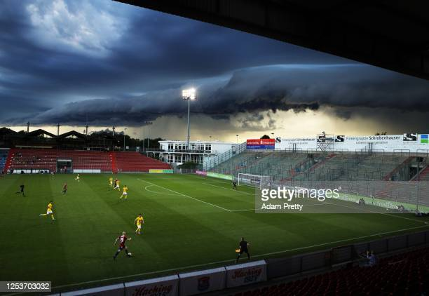 Maximilian Krauss of SpVgg Unterhaching controls the ball while a massive shelf cloud rolls in during the 3 Liga match between SpVgg Unterhaching and...