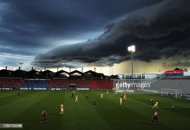 Maximilian Krauss of SpVgg Unterhaching makes a run while a massive shelf cloud rolls in during the 3 Liga match between SpVgg Unterhaching and FC...